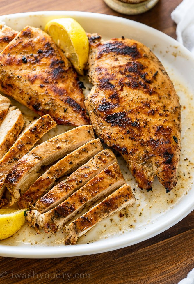 Juicy grilled chicken breast strips on a plate