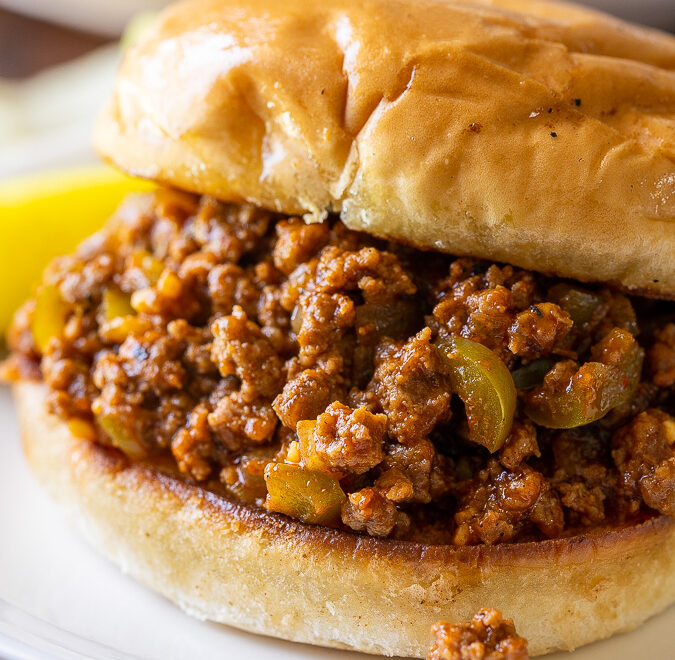 Skip the canned stuff, this homemade Easy Sloppy Joe Recipe is by far the BEST! Jam-packed with tender ground beef, peppers and onions in a lightly sweet and smokey sauce on a toasted bun.