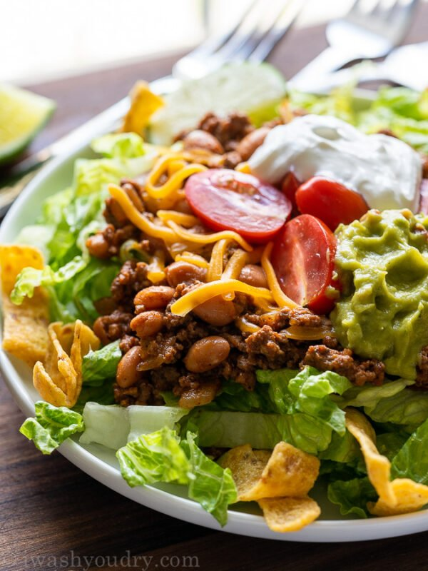 Close up of taco salad on white plate