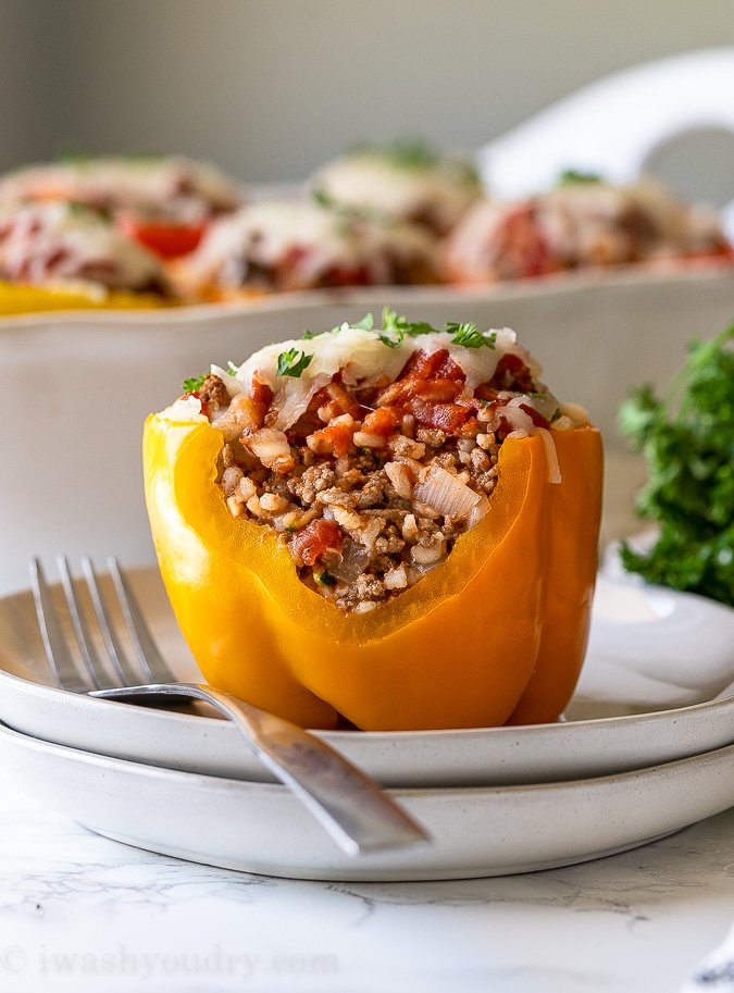 Side view of stuffed pepper with filling.