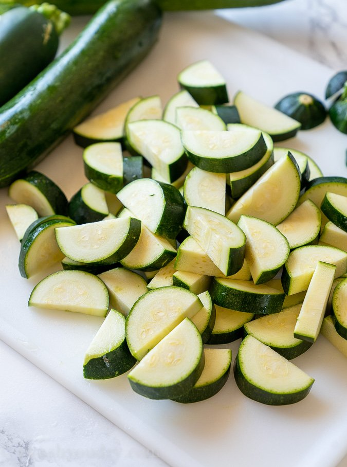 Cut zucchini into half moon shapes.