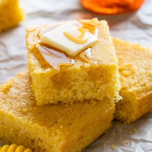 Cornbread slices with butter and honey on top
