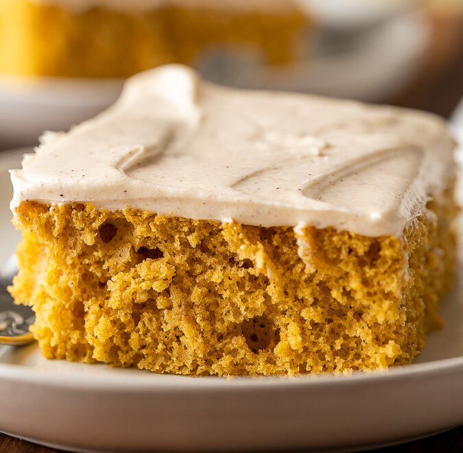 A plate of pumpkin cake with fork