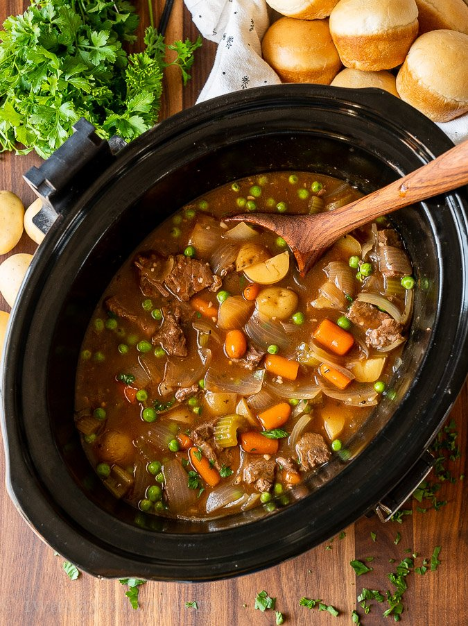 crock pot of stew with potatoes and carrots