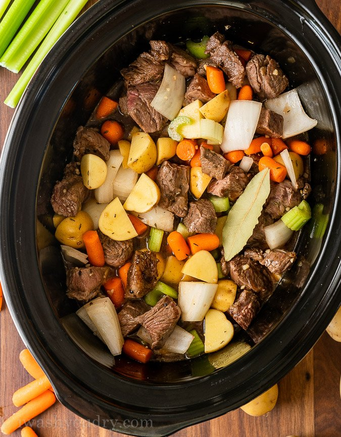 Ingredients for stew in a slow cooker