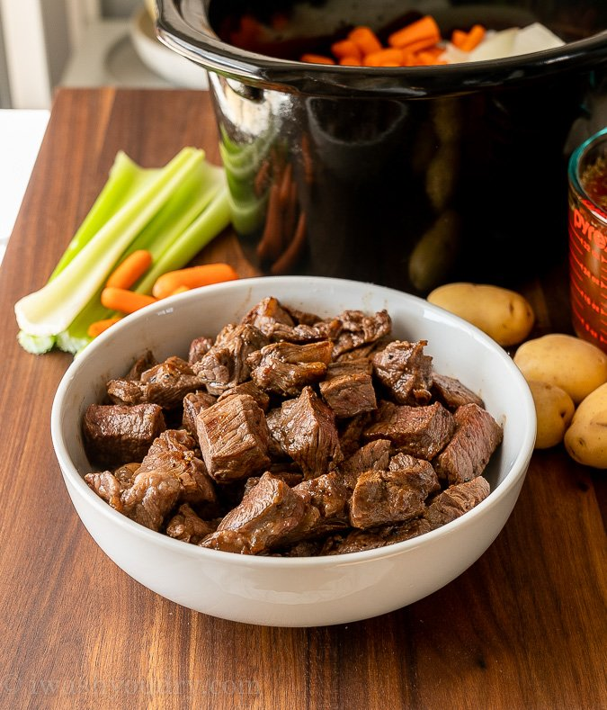 bowl of cooked beef chunks on table