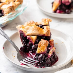 sliced of pie with blueberries