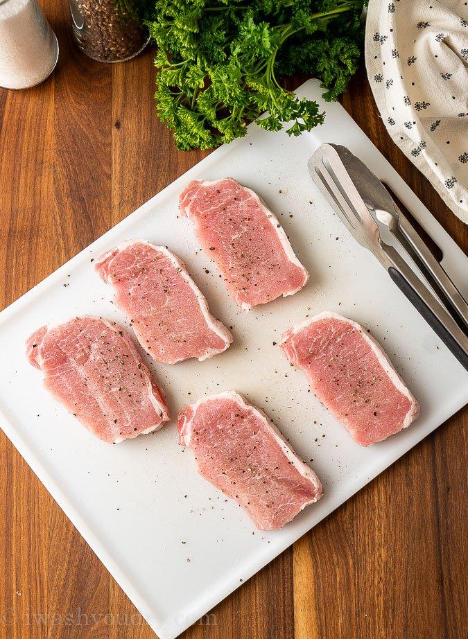 boneless pork chops on cutting board