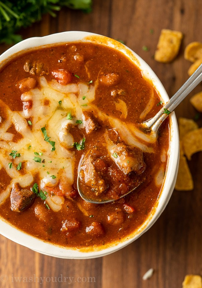 Beef chili in a bowl with spoon