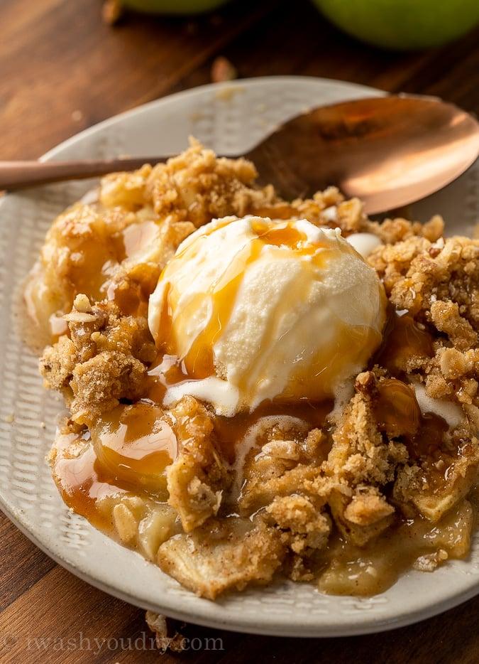 plate with apple crisp and vanilla ice cream