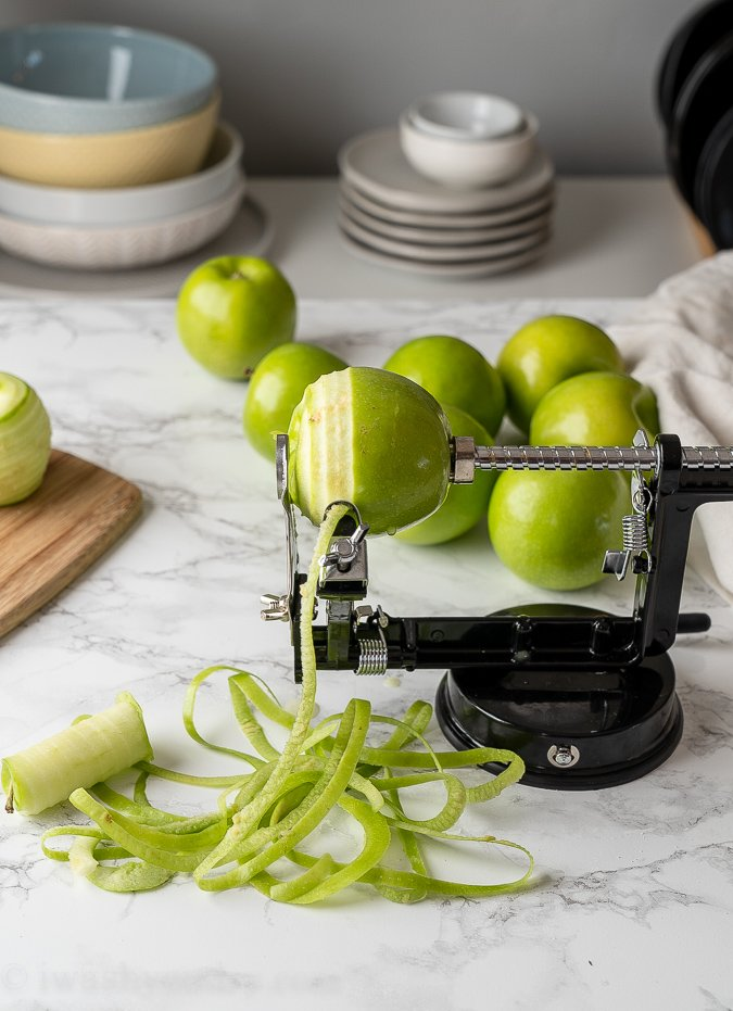 peeling apples on cutting board