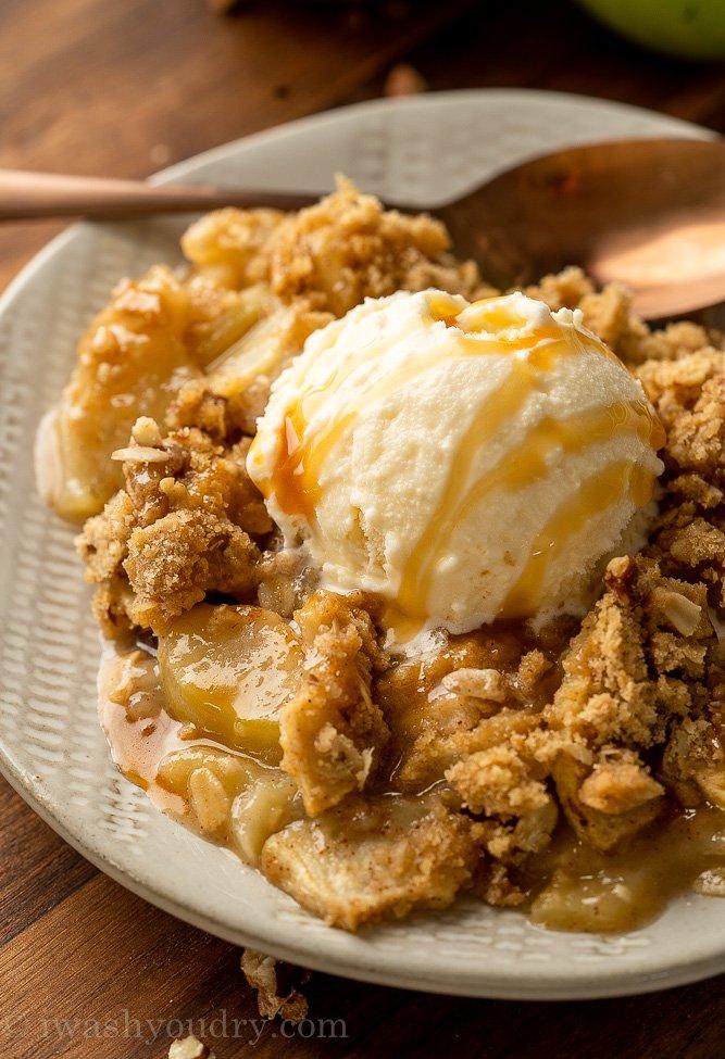 dessert on plate with apples and vanilla ice cream