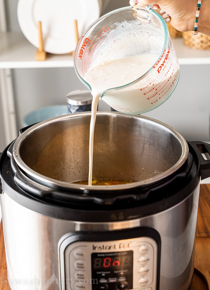 pouring cream mixture into soup