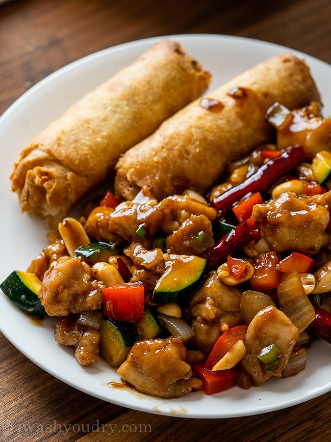 kung pao chicken on plate with vegetables