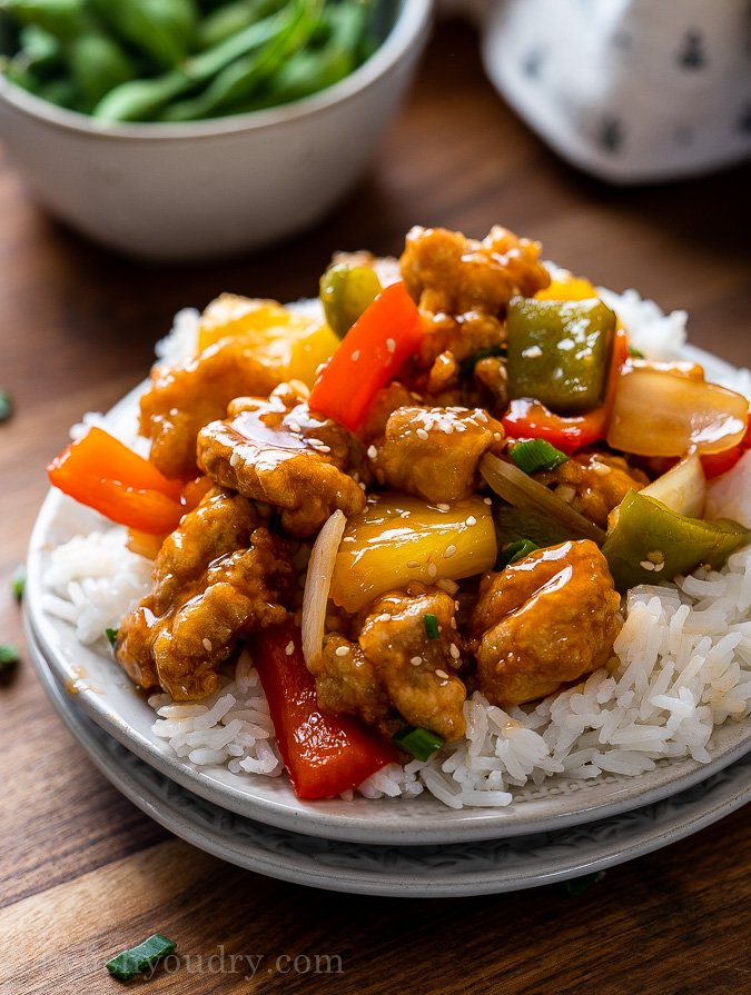 plate with rice and sweet and sour chicken and pineapple