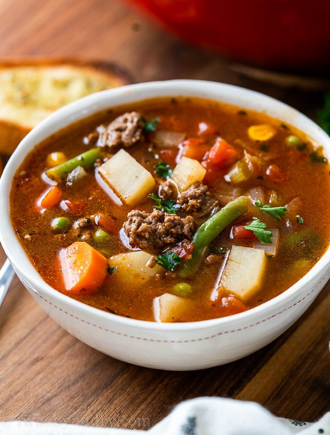 Bowl of vegetable soup with potatoes and ground beef