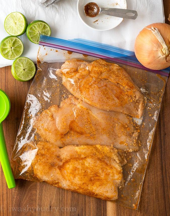 chicken breast marinating in ziplock bag