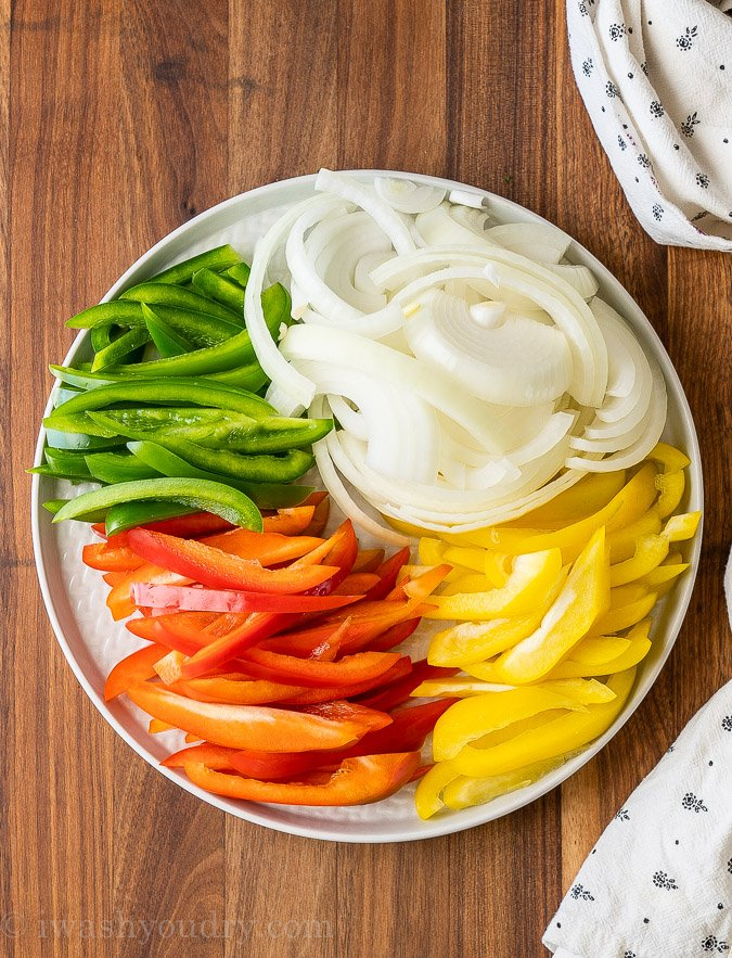 bell peppers and onions raw on plate