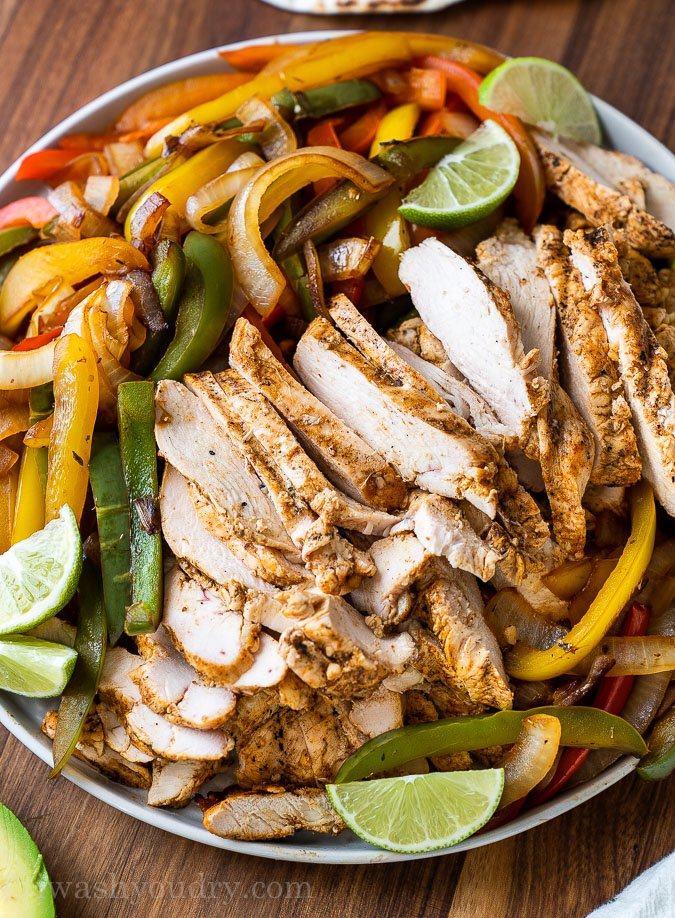 fajita chicken on plate with peppers and onions