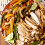 Plate with peppers, onions, limes and grilled chicken