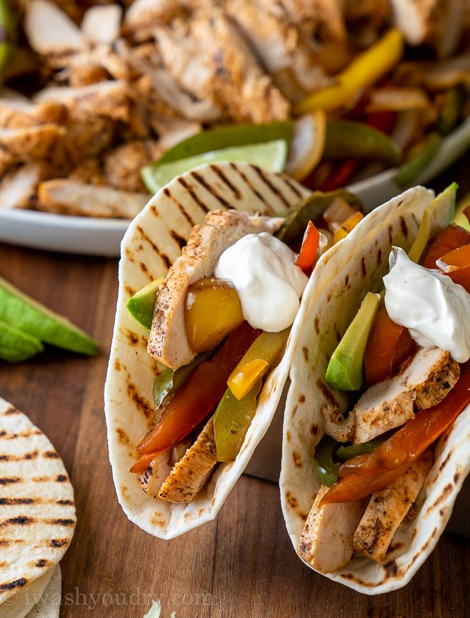 chicken and peppers in tortilla with sour cream