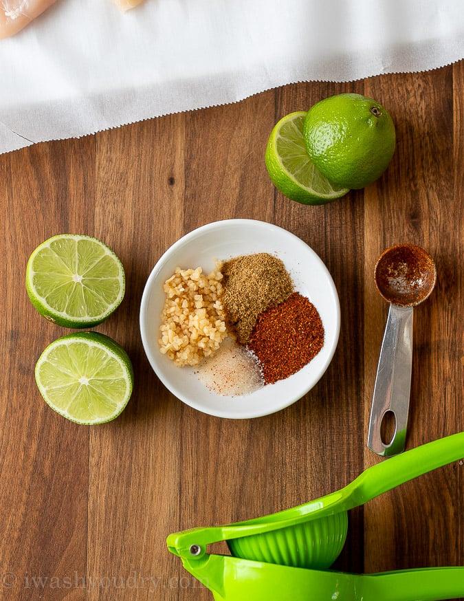 chicken fajita marinade ingredients on cutting board