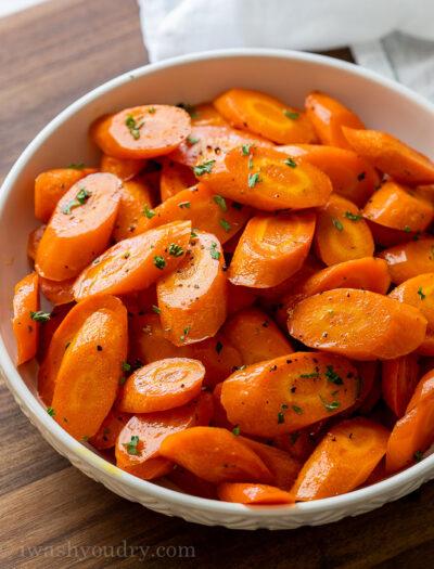 white bowl full of sliced roasted carrots
