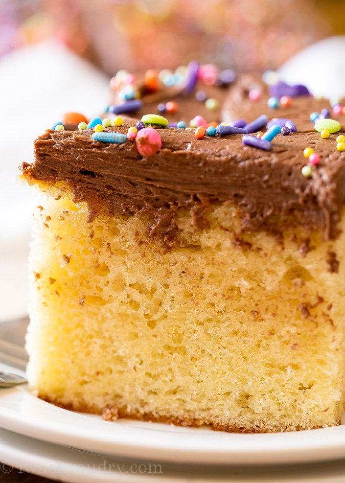 close up picture of vanilla cake with frosting