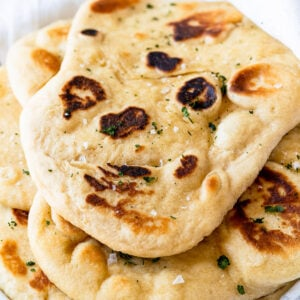 pile of soft naan bread on plate