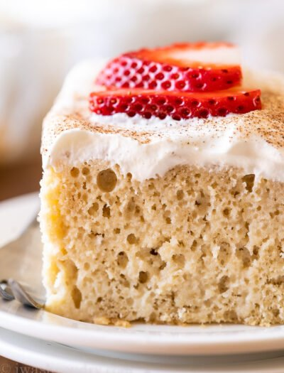 Tres Leches Cake recipe with whipped cream and strawberries