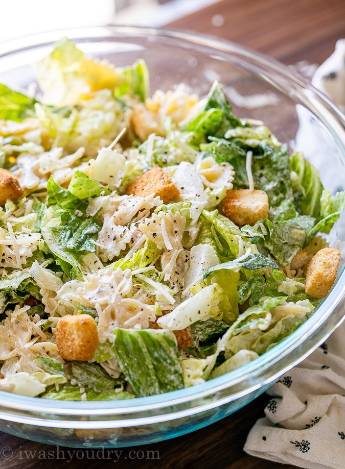 bowl of salad with pasta and dressing