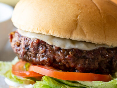 juicy burger with melted cheese on a hamburger bun