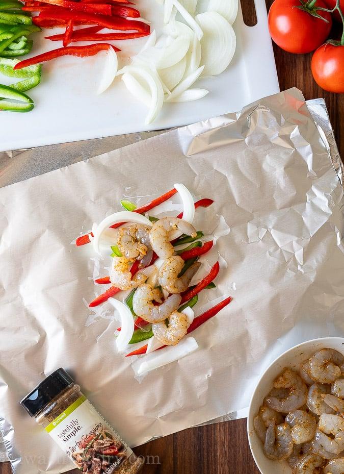 arrange shrimp and peppers on foil sheet