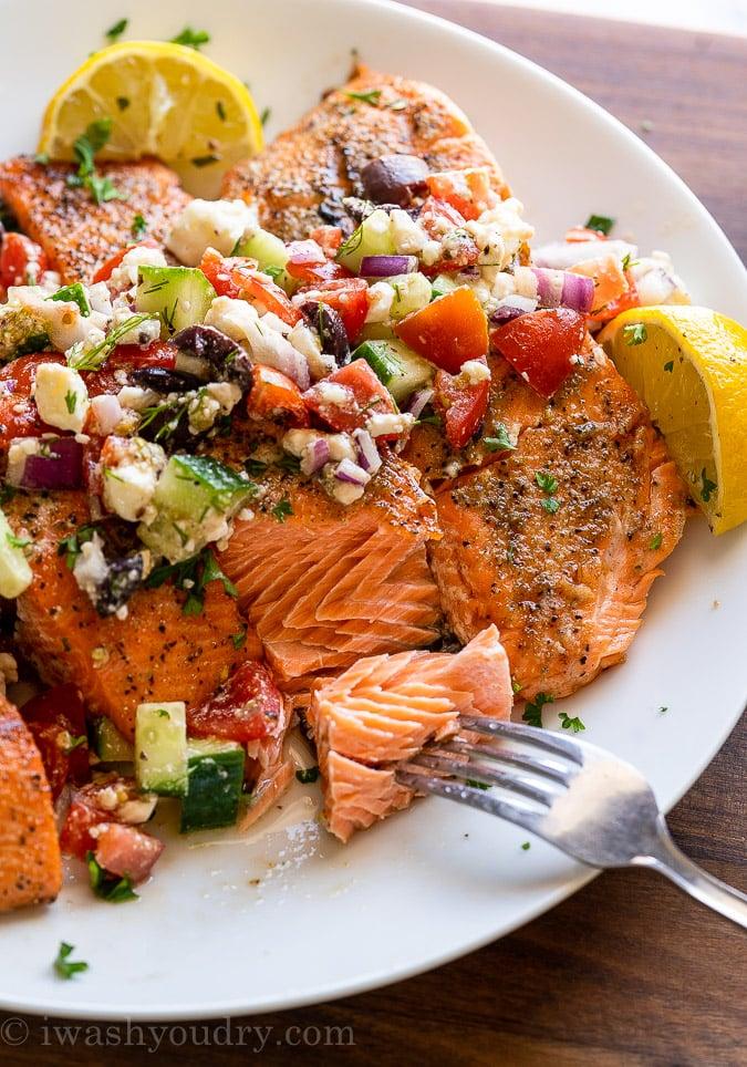 flaky salmon with greek salsa on top
