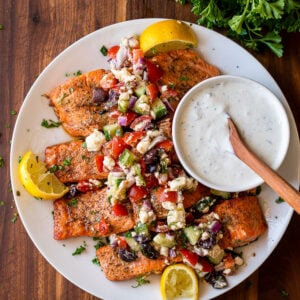 easy grilled salmon recipe with fresh greek salsa on top and side of tzatziki sauce