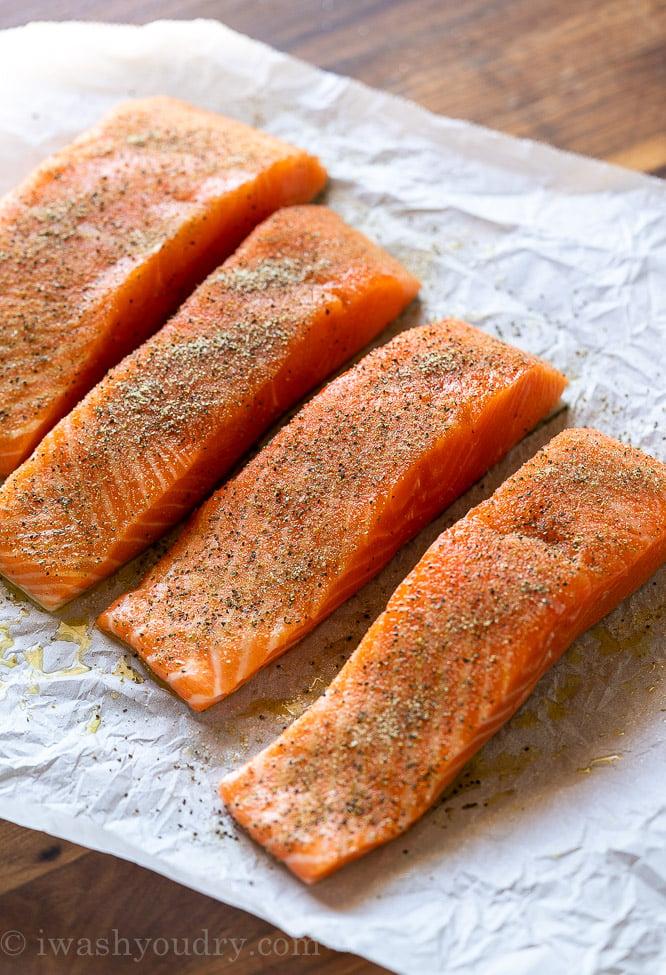 wild caught salmon filets on parchment paper