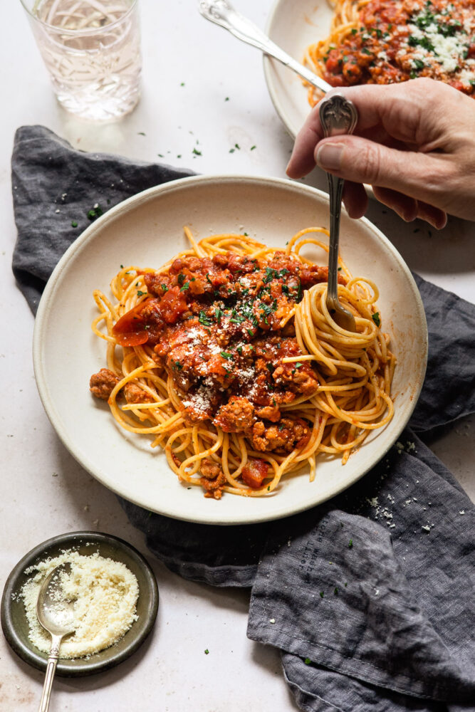 twirling pasta on fork with spaghetti sauce