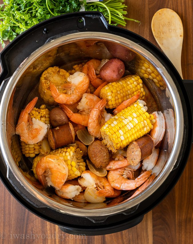 pressure cooker filled with shrimp, corn and potatoes