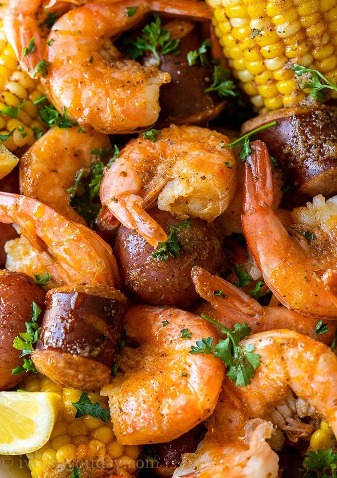 closeup of shrimp boil recipe with potatoes sausage and corn
