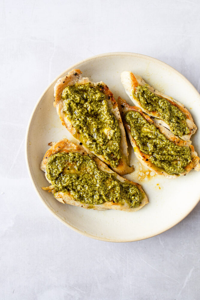 sear chicken then top with basil pesto