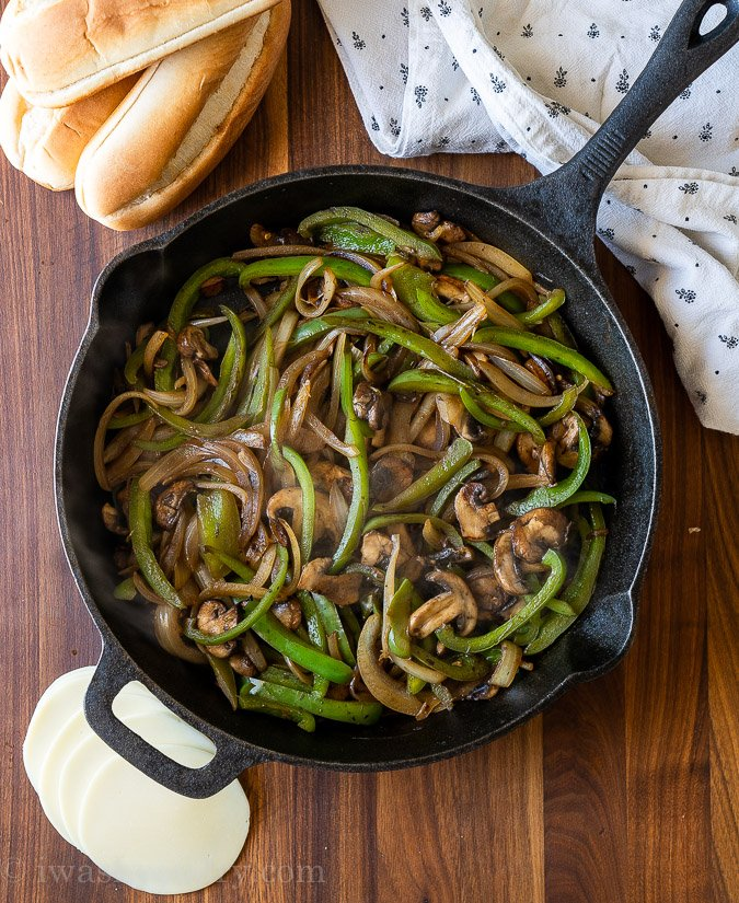 bell peppers and onions in cast iron pan