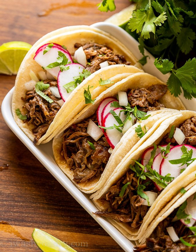 slow cooker barbacoa beef in taco shells with radish