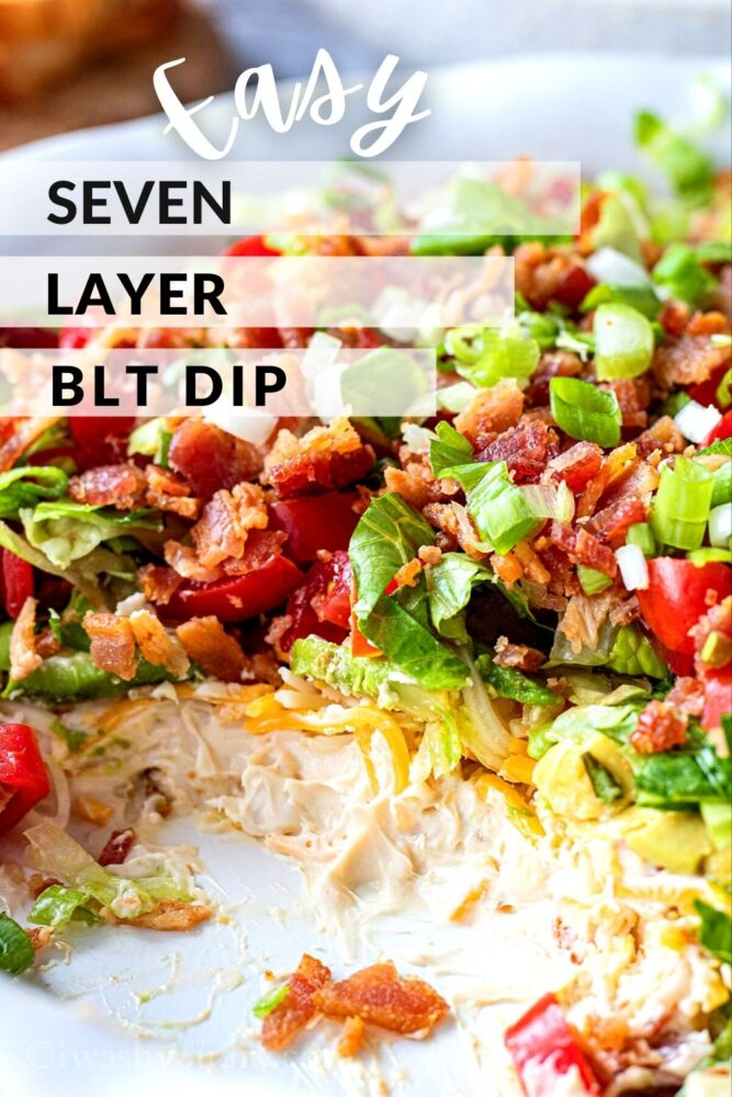 """cream cheese, cheddar cheese, lettuce, tomatoes, bacon and green onions in a white pan with text overlay reading """"easy seven layer BLT Dip"""""""