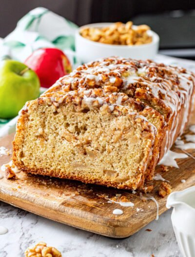 Slices of apple fritter bread on wood cutting board
