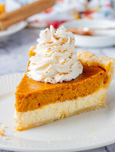 Slice of Pumpkin cheesecake pie on white plate.