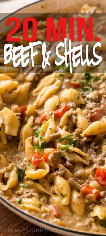 Close up picture of ground beef and pasta shells in creamy sauce.